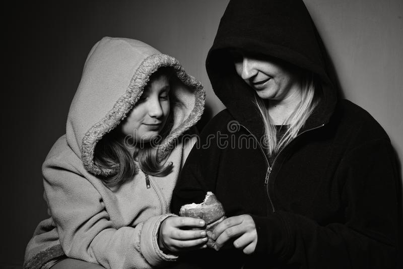 Homeless mother with her daughter. Poor family royalty free stock photos