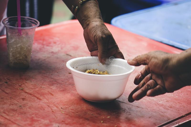 Homeless and needy people receive help, receive food from volunteers : concept of food donation.  royalty free stock photography