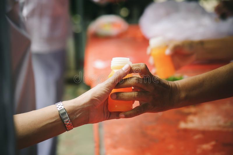 Homeless and needy people receive help, receive food from volunteers : concept of food donation.  royalty free stock image