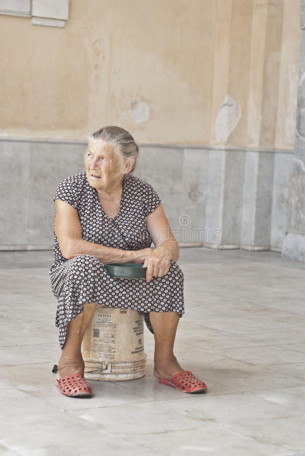 Download A Homeless Old Woman Asking For Help Editorial Photography - Image: 27405167