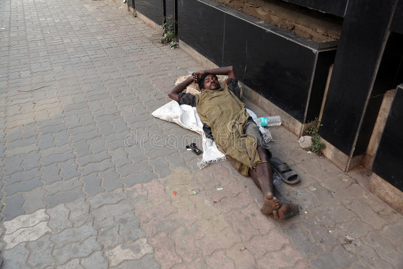 Homeless people sleeping on the footpath of Kolkata. India royalty free stock photo