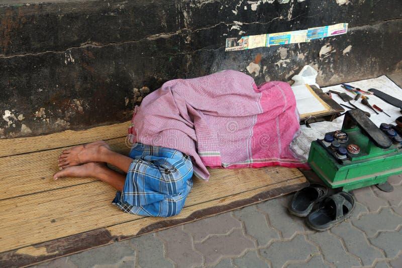 Homeless people sleeping on the footpath of Kolkata. India stock photography