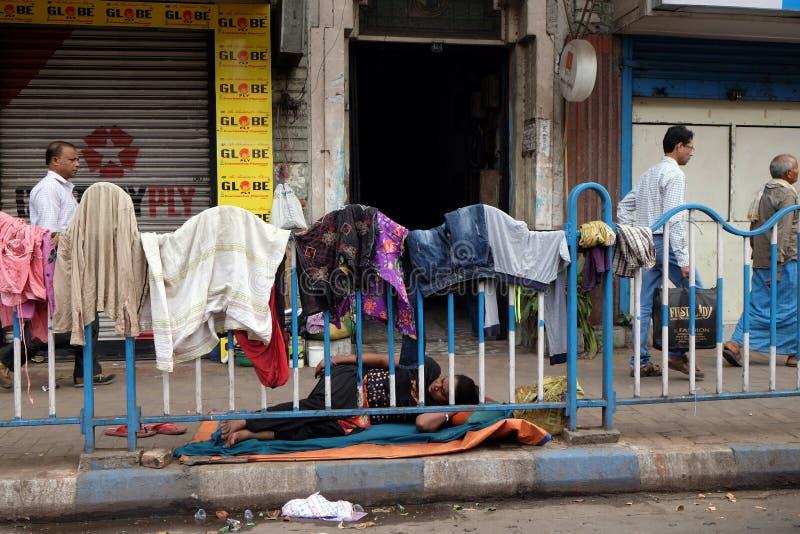 Homeless people sleeping on the footpath of Kolkata. India royalty free stock photos
