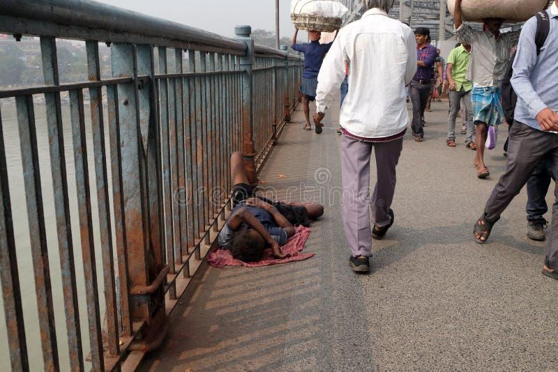 Homeless people sleeping on the footpath of Kolkata. India stock image