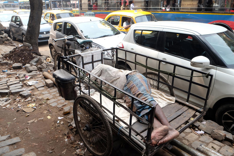 Homeless people sleeping on the footpath of Kolkata. India stock images