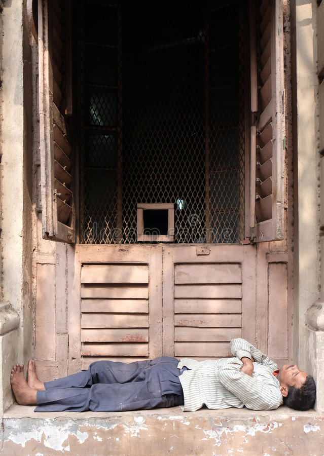 Homeless people sleeping on the footpath of Kolkata. India stock photos