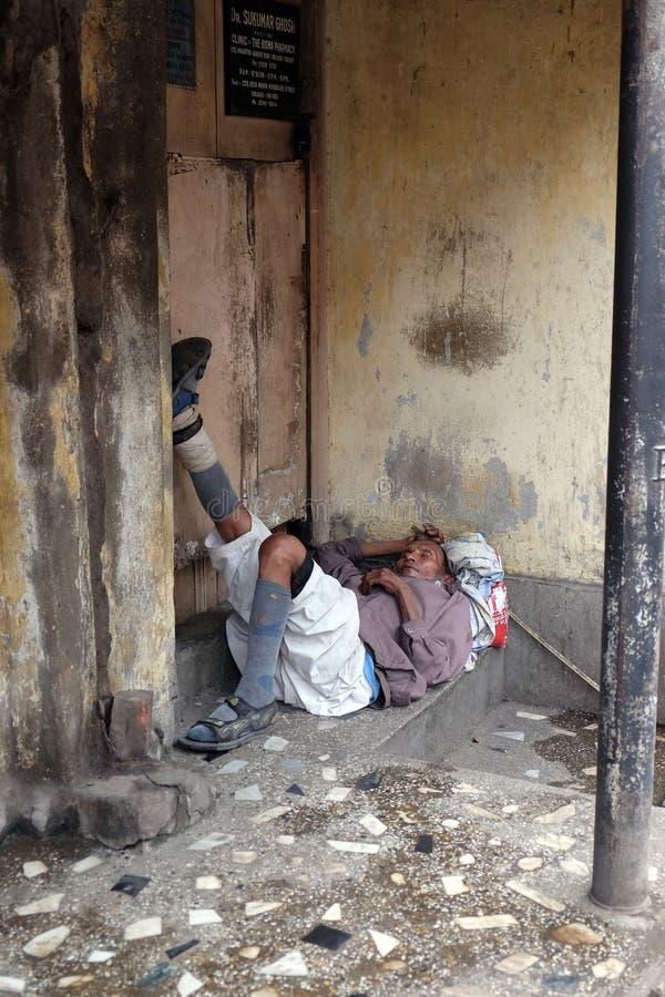 Homeless people sleeping on the footpath of Kolkata. India royalty free stock photography