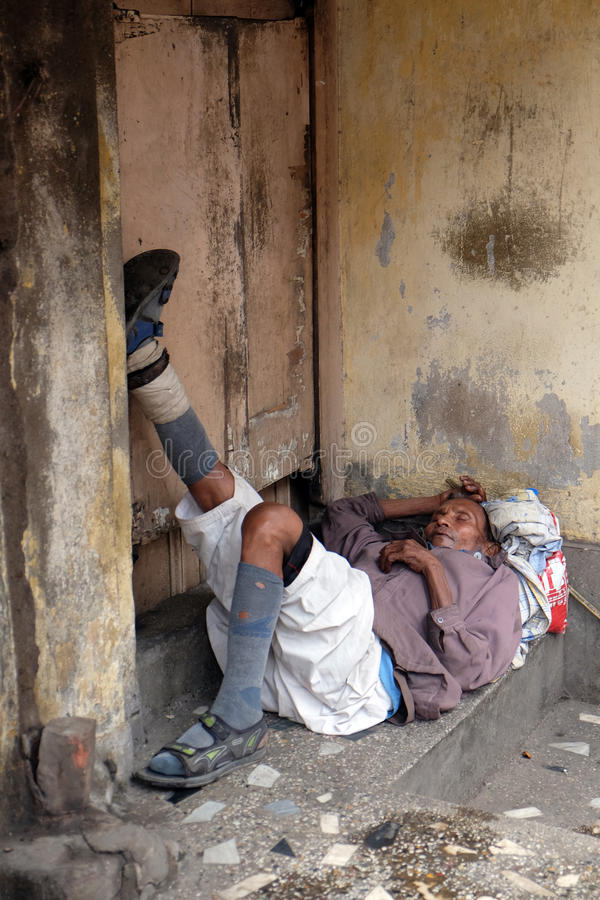 Homeless people sleeping on the footpath of Kolkata. India royalty free stock images