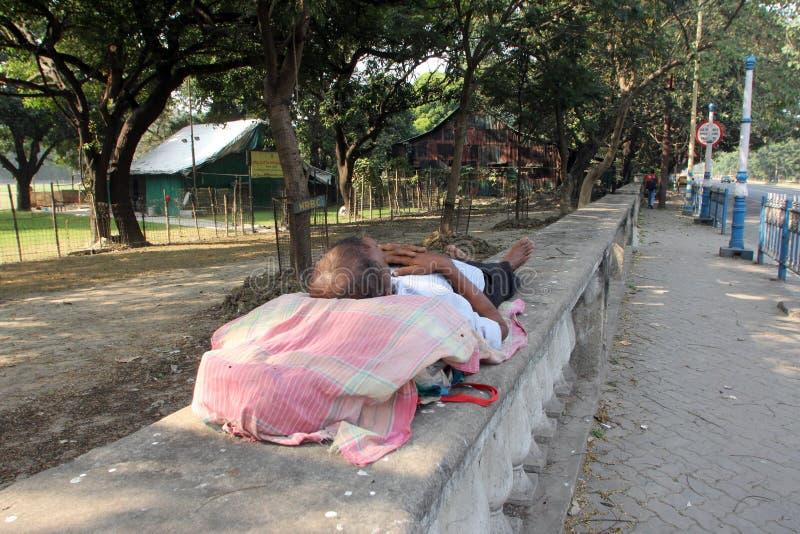 Homeless people sleeping on the footpath of Kolkata. On November 25, 2012 in Kolkata, India royalty free stock photos