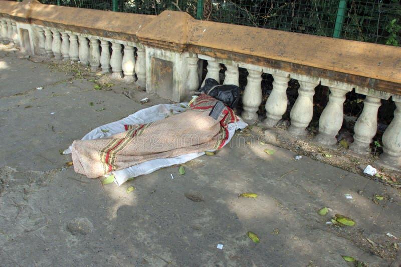 Homeless people sleeping on the footpath of Kolkata. On November 26, 2012 in Kolkata, India royalty free stock photography