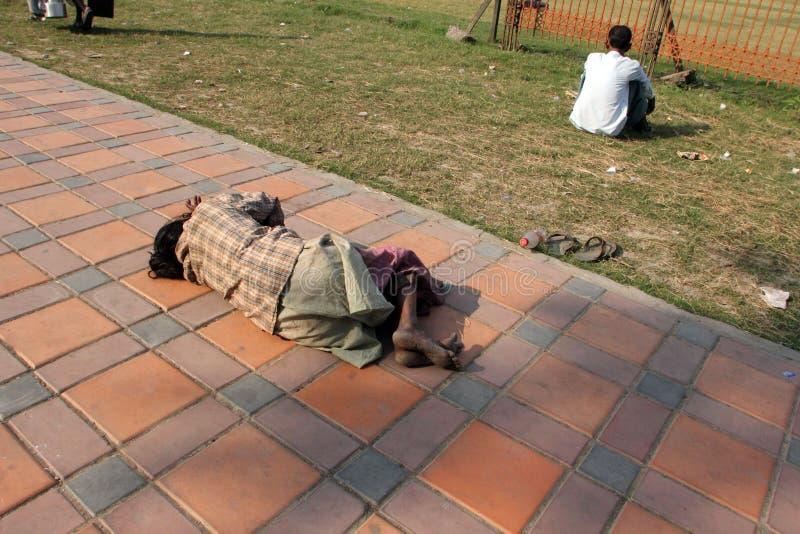 Homeless people sleeping on the footpath of Kolkata. On November 25, 2012 in Kolkata, India stock photo