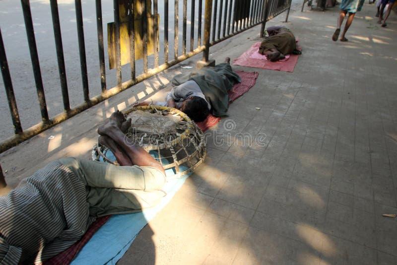 Homeless people sleeping on the footpath of Kolkata. On November 28, 2012 in Kolkata, India stock photos