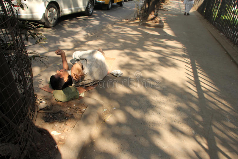 Homeless people sleeping on the footpath of Kolkata. On November 28, 2012 in Kolkata, India royalty free stock photo