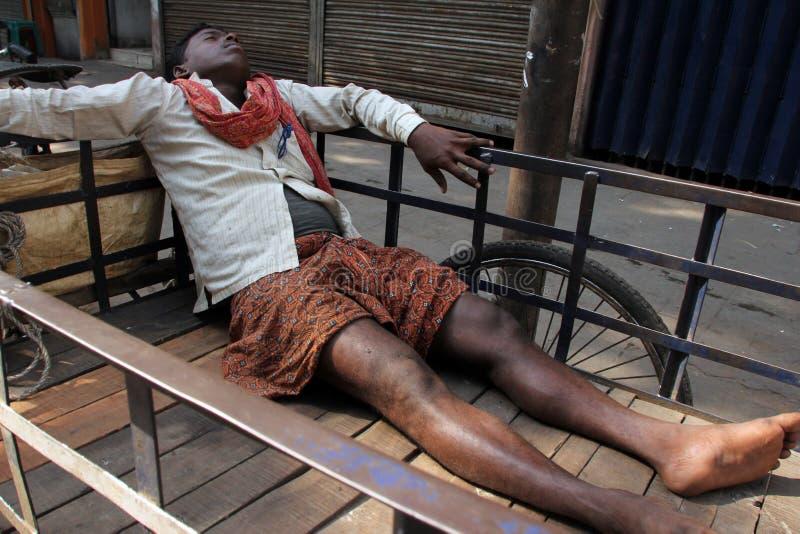 Homeless people sleeping on the footpath of Kolkata. On November 28, 2012 in Kolkata, India royalty free stock photos