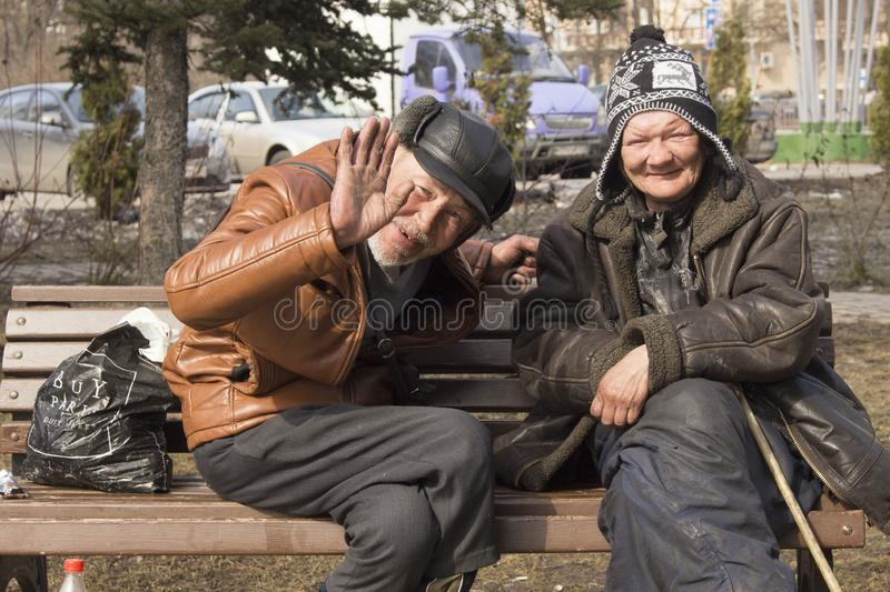 Homeless people on the street. Poverty in the Third World. Woman and man live on the street. Disadvantage and poverty. Vices of capitalism. Food and water for stock photos