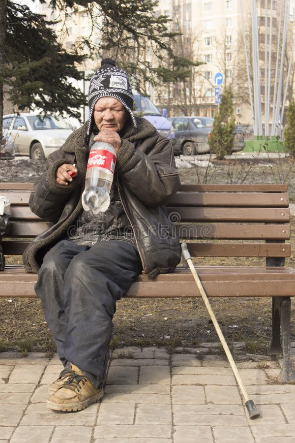 Homeless people on the street. Poverty in the Third World. Woman and man live on the street. Disadvantage and poverty. Vices of capitalism. Food and water for royalty free stock photos
