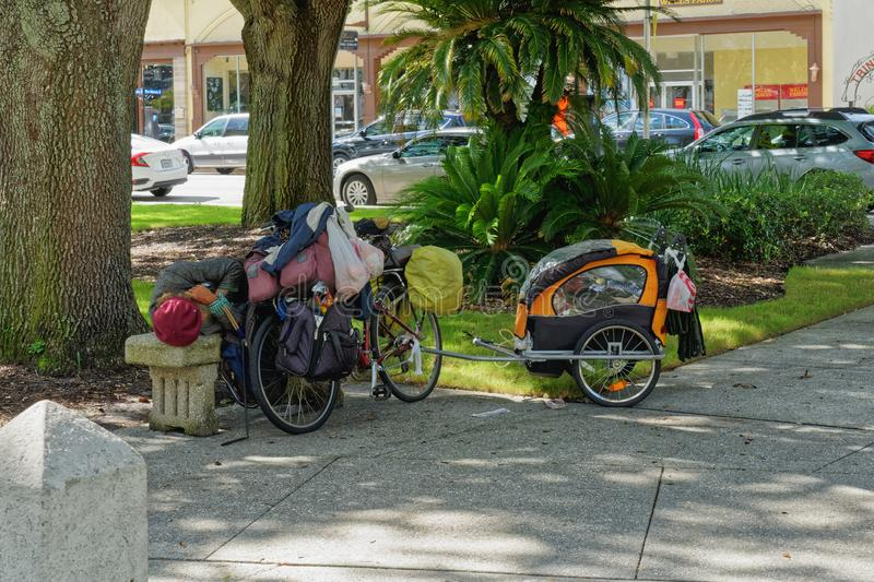 Homeless person is sleeping on a bench royalty free stock images