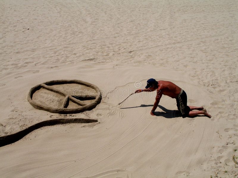 Homeless sand artist. A homeless vet making sand sculptures on the beach in Santa Barbara stock photo