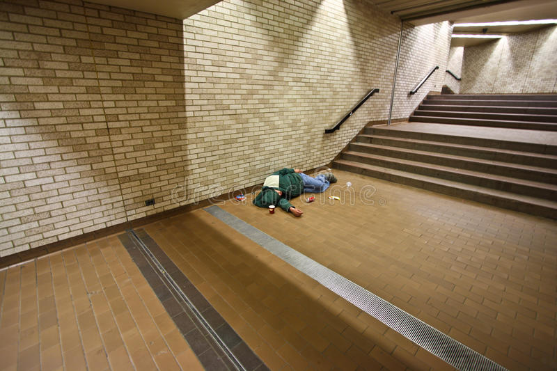 Homeless sleeping on the ground royalty free stock photography