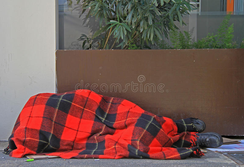 Homeless is sleeping outdoor in Milan, Italy stock image
