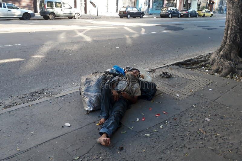 Homeless sleeping. Rio de Janeiro, Brazil, September 3, 2018.nHomeless sleeping on the sidewalk of Freia Caneca street in downtown Rio de Janeiro royalty free stock photo