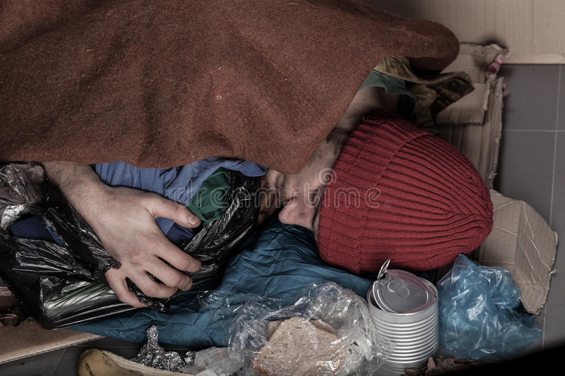 Homeless sleeping on the street stock image