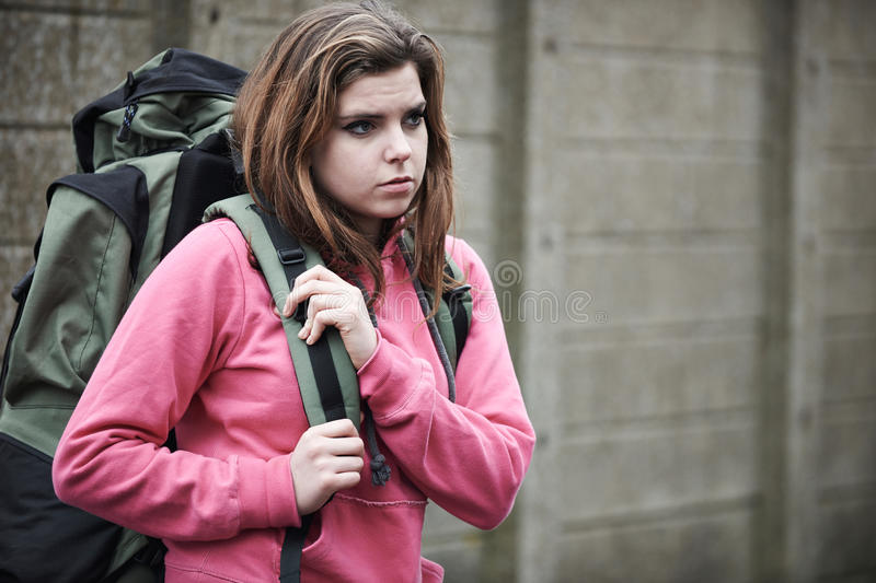 Homeless Teenage Girl On Streets With Rucksack stock image