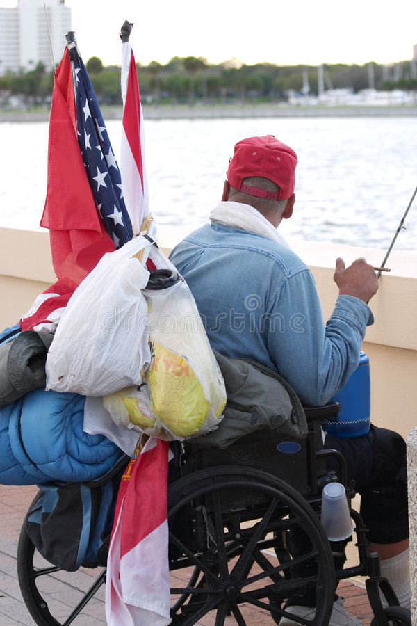 Homeless Vet 2. Homeless veteran in a wheelchair looking out at the ocean