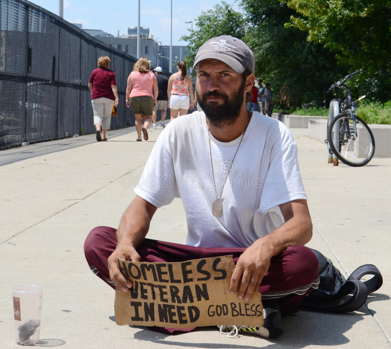 Homeless veteran begs for money straight on. DETROIT, MI - JULY 6: Homeless veteran begs for money in Detroit, MI on July 6, 2014 royalty free stock image