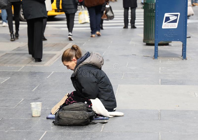 Homeless voman at 5th Avenue in Midtown Manhattan. NEW YORK - MARCH 7, 2019: Homeless woman at 5th Avenue in Midtown Manhattan stock image