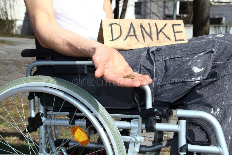 Homeless wheelchair user. Asking for money royalty free stock image