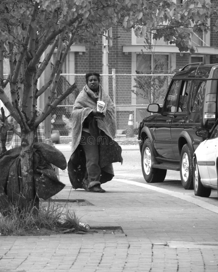 Homeless Woman. A homeless woman begging on the city streets stock images