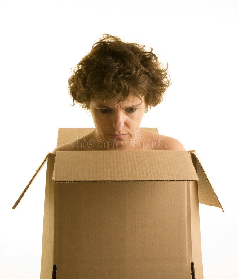 Homeless woman isolated on white. Homeless woman wearing a cardboard box looking depressed stock images
