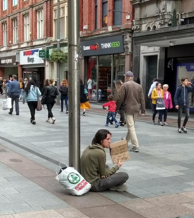 Homeless young man begging in Dublin royalty free stock photography