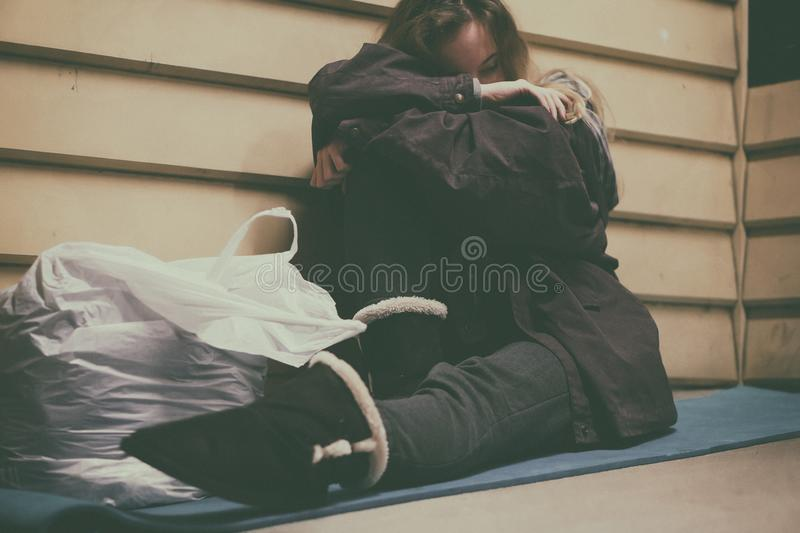 Homeless young teen taking shelter royalty free stock photo