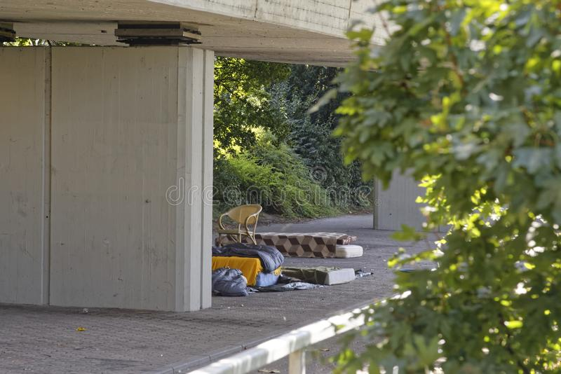 Homelessness. Camp of homeless people living under a bridge royalty free stock image