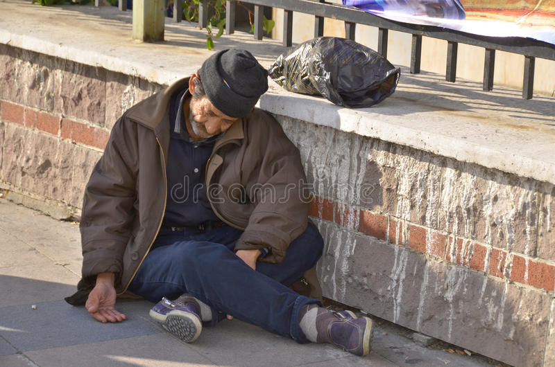 Homelessness Muslim man. ISTANBUL TURKEY OCTOBER 08: Homelessness Muslim man sleep on the side walk in the heart of downtown Istanbul on october 08 2013. The royalty free stock photography