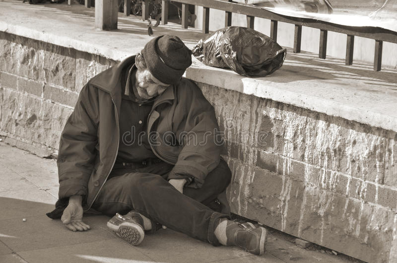 Homelessness Muslim man. ISTANBUL TURKEY OCTOBER 08: Homelessness Muslim man sleep on the side walk in the heart of downtown Istanbul on october 08 2013. The royalty free stock photos