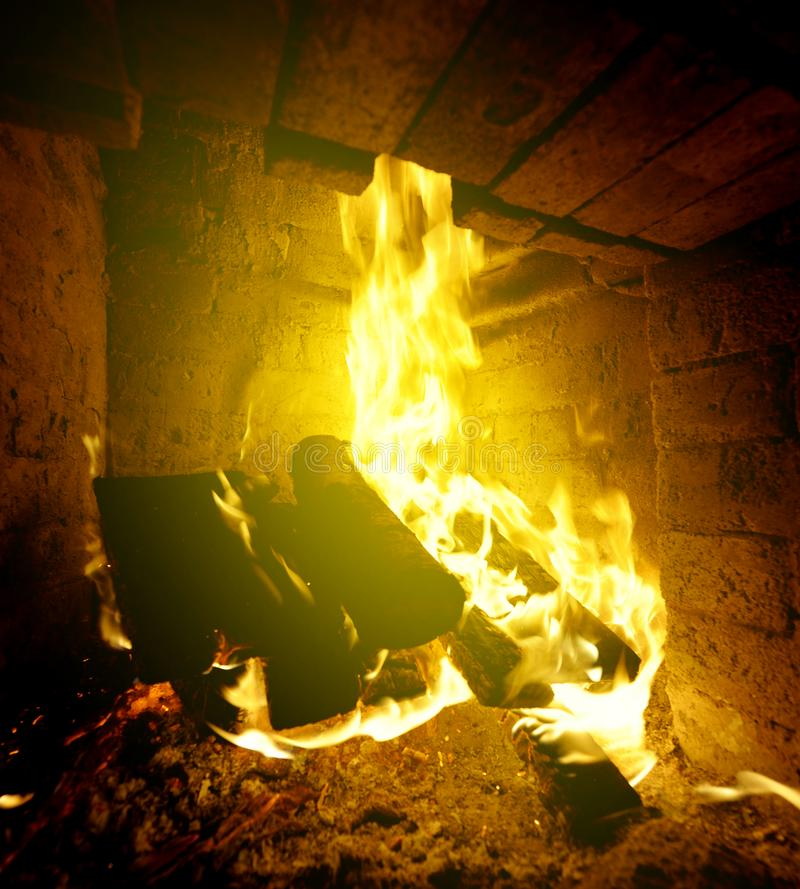 Log Fire on winter night. Homely warm log fire on a cold winter day stock photos