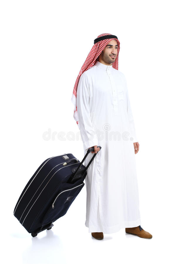 Homem árabe do saudita do viajante que leva uma mala de viagem foto de stock royalty free