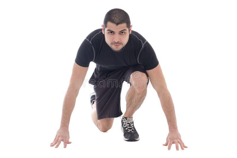 Homem árabe farpado considerável em pronto para ser executado do sportswear isolado fotografia de stock