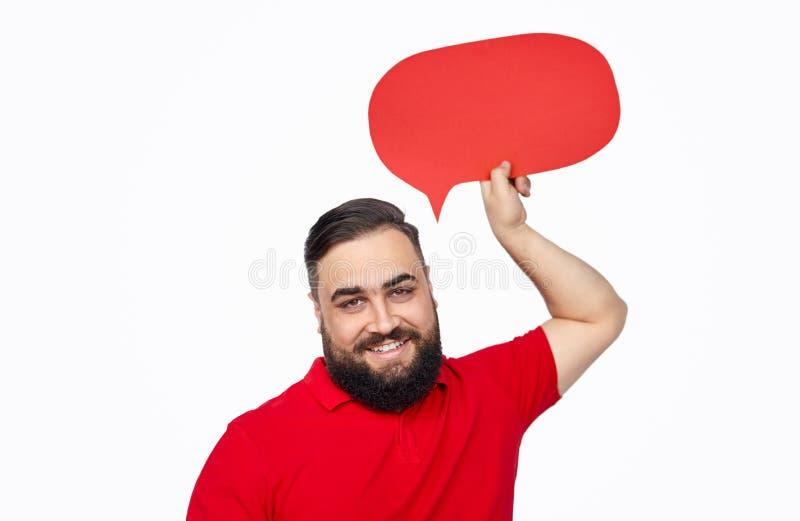Homem étnico alegre com bolha do discurso fotos de stock royalty free