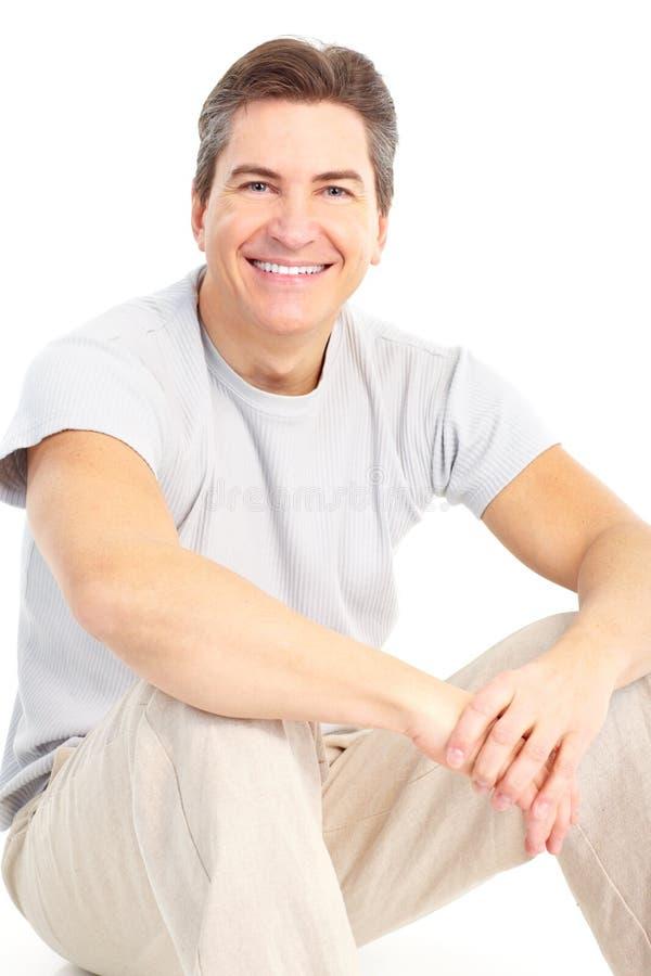Download Homem imagem de stock. Imagem de sente, se, sorrir, ocasional - 12805373