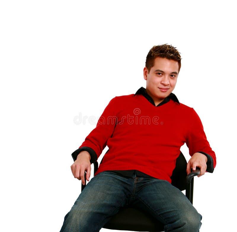 Homem adulto asiático assentado fotografia de stock royalty free