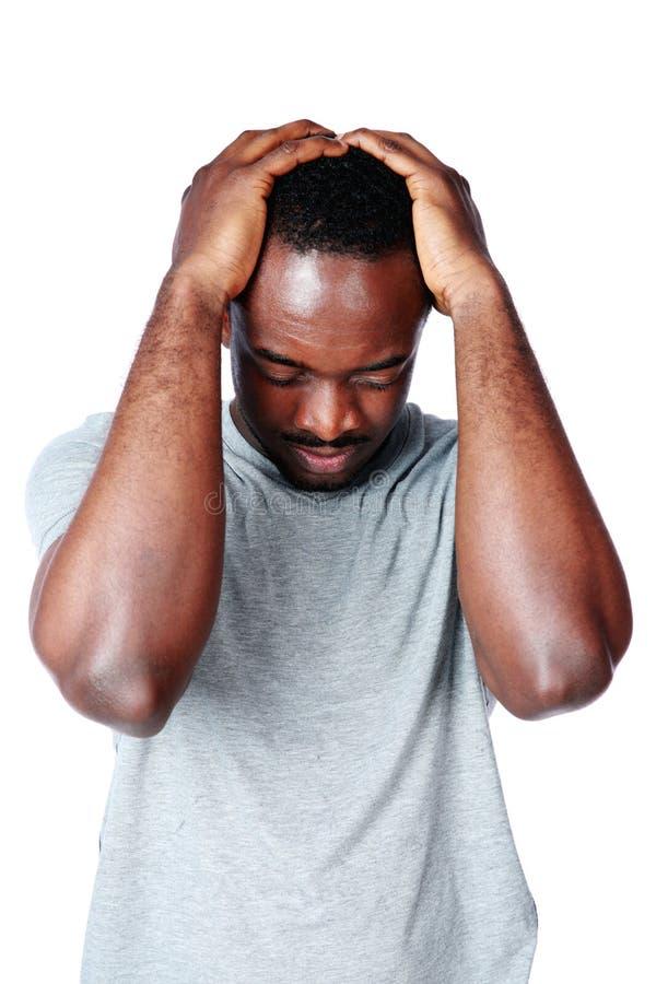 Homem africano que tem a dor de cabeça foto de stock