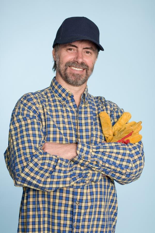 Homem alegre no tampão imagens de stock