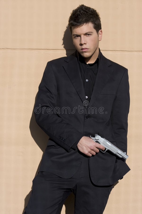Homem armado elegante vestido. imagem de stock royalty free