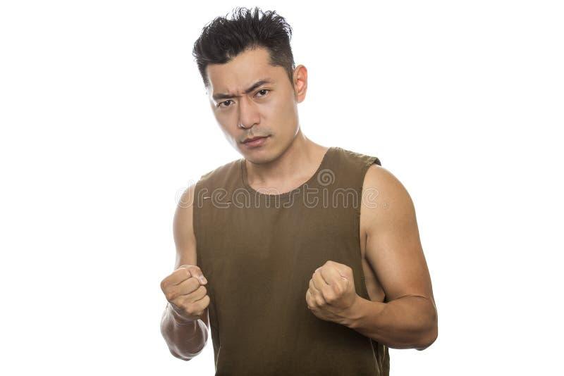 Homem asiático atlético irritado fotografia de stock