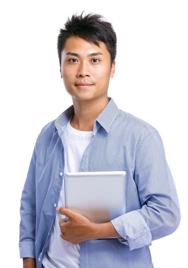 Homem asiático com computador da tabuleta foto de stock royalty free