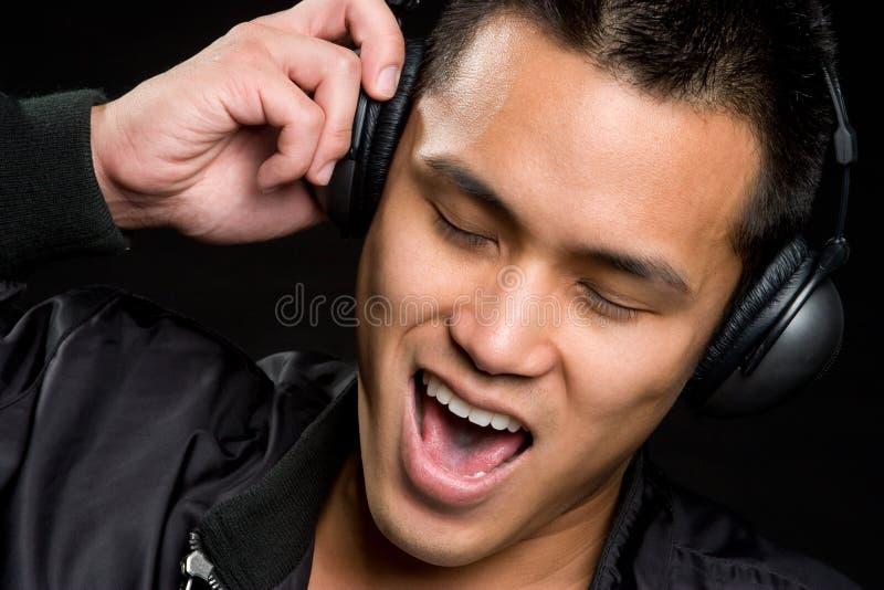 Homem asiático da música imagem de stock royalty free